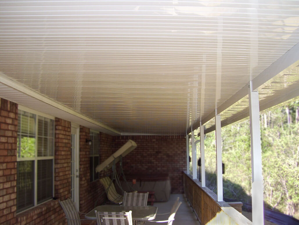 Patio cover with riser pan roof