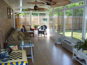 Interior of sunroom with tile floor.