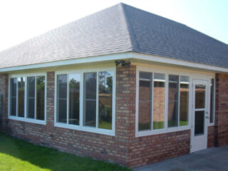 Glass enclosure with brick.