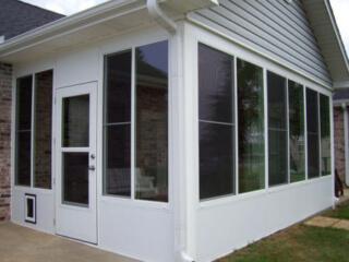 Patio enclosure with pet door