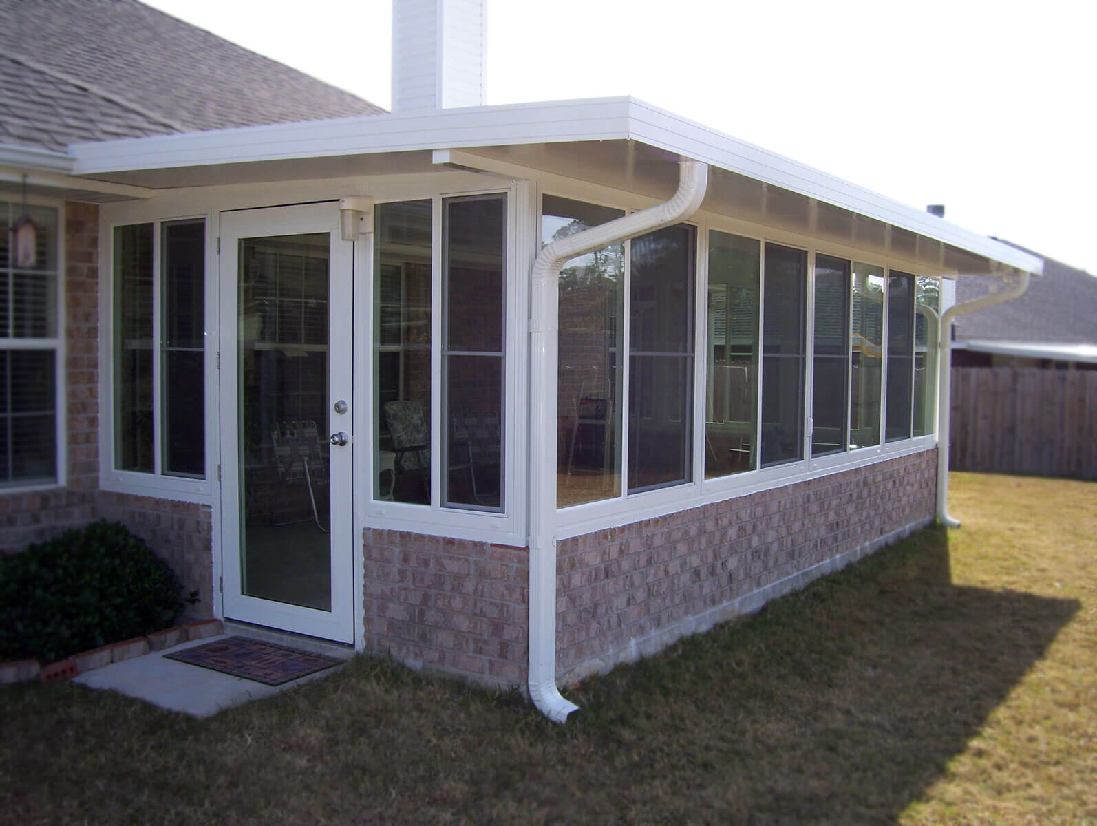 Sunrooms pensacola fl patio enclosures sun rooms for Backyard sunroom