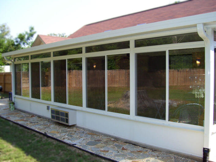 Horizontal slider windows with transoms on this sun room in Pensacola.