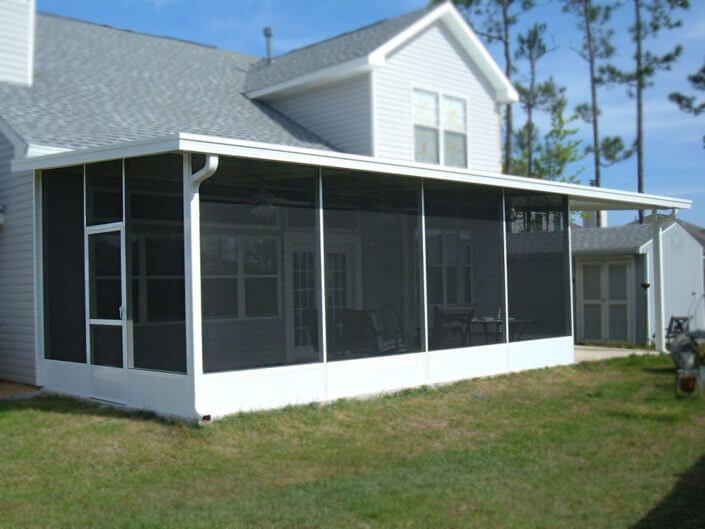 Screen enclosure with riser pan roof